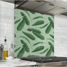 Fond de hotte vert pâle avec feuilles de bananier