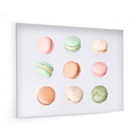 Fond de hotte crème avec macarons divers : chocolat, framboise, pistache, vanille