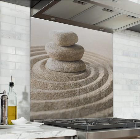 Fond de hotte ambiance zen avec sable et galets