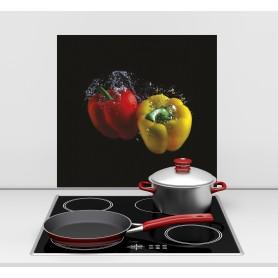 Fond de hotte noir avec duo de poivrons rouge et jaune